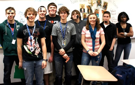 Students of French Club gather at the end of a game called