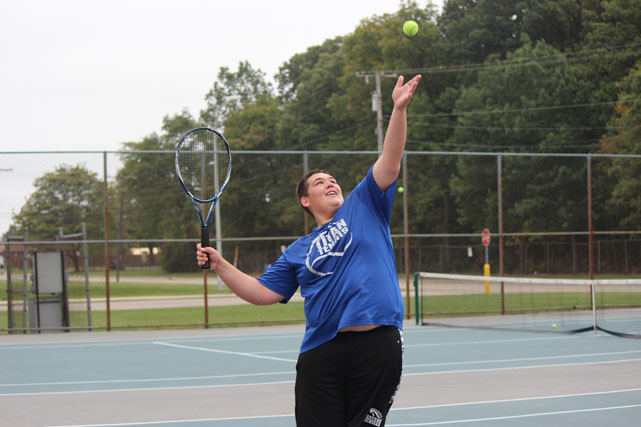 Joe Barber serves for the set during an early season home match.