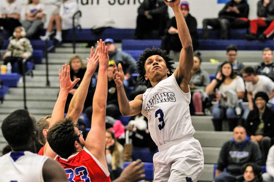 Titans Beat Rival in Opening Basketball Game